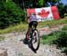Emily Batty climbs past the flag erected by her family 		CREDITS:  		TITLE: 2013 MTB Nationals 		COPYRIGHT: Rob Jones/www.canadiancyclist.com 2013 -copyright -All rights retained - no use permitted without prior, written permission