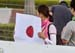A home made flag from a Japanese fan 		CREDITS:  		TITLE: 2016 Road World Championships, Doha, Qatar 		COPYRIGHT: Rob Jones/www.canadiancyclist.com 2016 -copyright -All rights retained - no use permitted without prior; written permission