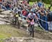 Batty clips back in after her near crash 		CREDITS:  		TITLE: 2018 La Bresse MTB World Cup 		COPYRIGHT: Rob Jones/www.canadiancyclist.com 2018 -copyright -All rights retained - no use permitted without prior; written permission