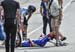 Duchesne on the ground after crashing into a spectator who wandered out onto the road 		CREDITS:  		TITLE: Canadian Road National Championships - RR 		COPYRIGHT: Rob Jones/www.canadiancyclist.com 2018 -copyright -All rights retained - no use permitted wit