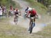 Fincham looks to see what sort of a gap he has on Disera as they start the last lap 		CREDITS:  		TITLE: 2018 MTB XC Championships - Team Relay 		COPYRIGHT: Rob Jones/www.canadiancyclist.com 2018 -copyright -All rights retained - no use permitted without