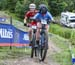 Samuelle Baillargeon (Canada) getting photo bombed by Natalia Marie Torres Macouzet (Mexico) 		CREDITS:  		TITLE: World MTB Championships, 2019 		COPYRIGHT: Rob Jones/www.canadiancyclist.com 2019 -copyright -All rights retained - no use permitted without