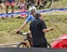 Carter Woods and coach Dan Proulx 		CREDITS:  		TITLE: Team Relay World MTB Championships, 2019 		COPYRIGHT: Rob Jones/www.canadiancyclist.com 2019 -copyright -All rights retained - no use permitted without prior, written permission